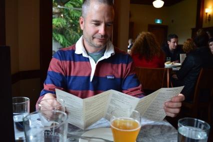 Chris with his accordion menu of beers.